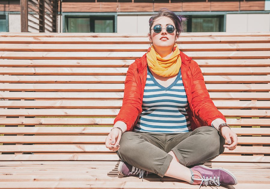 Beautiful Fashion Hipster Woman Doing Yoga On The Bench