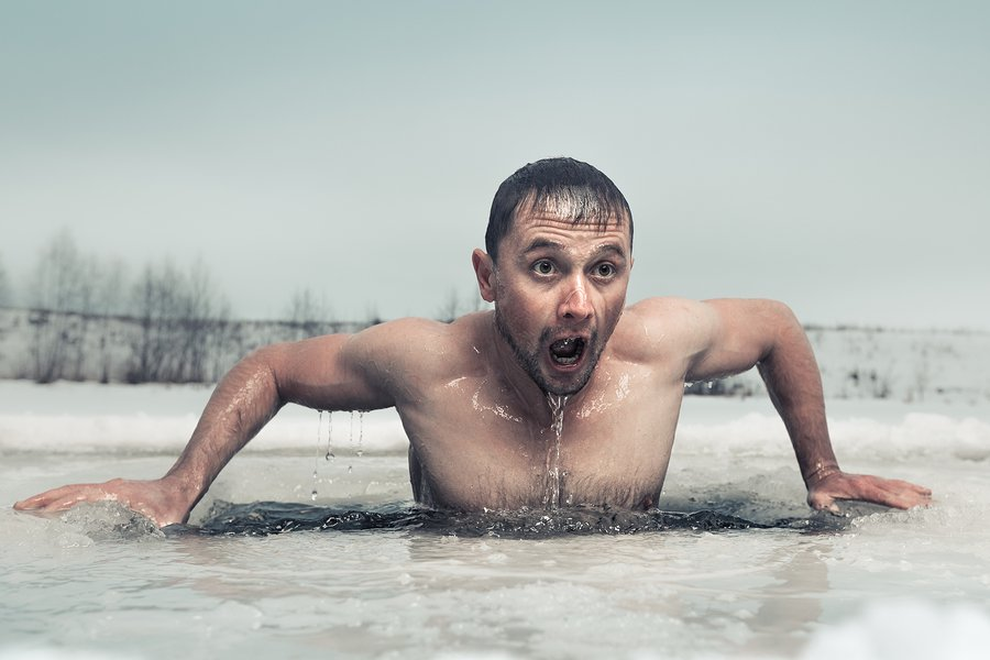 emotional thumbnail example - man swimming in the ice hole with emotional face