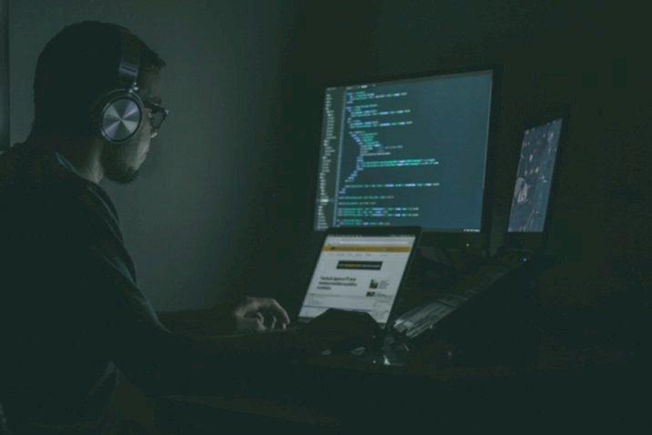 guy looking at computer