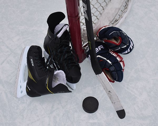 Hockey glove stick and puck